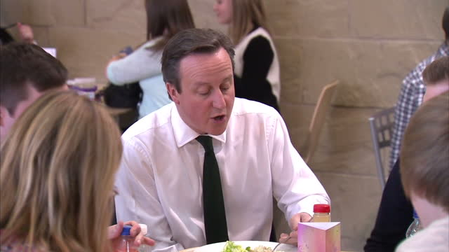 Interior shots of Prime Minister David Cameron meeting employees at Scottish Widows having lunch on March 14 2014 in Edinburgh Scotland