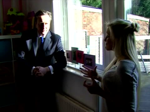 interior shots of prime minister david cameron speaking to sharon may a firsttime buyer who was able to purchase her home through the government's... - 英国ハンプシャー点の映像素材/bロール