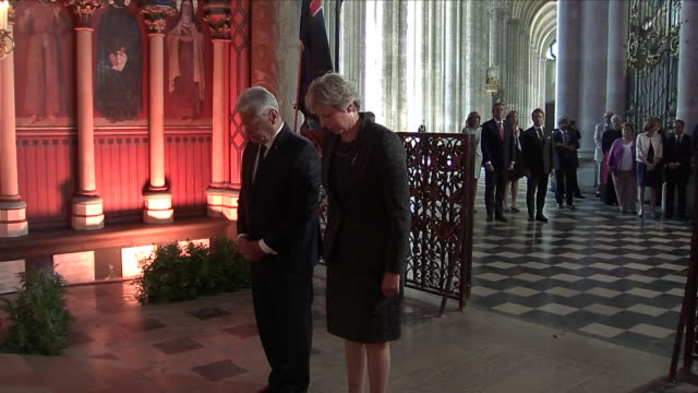 interior shots of prime minister theresa may laying a wreath in amiens cathedral in a ceremony to mark 100 years since the ww1 battle of amiens on 8... - 花輪を捧げる点の映像素材/bロール