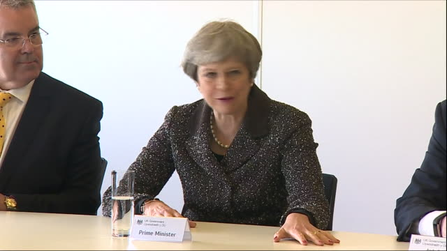 Interior shots of Prime Minister Theresa May sat around a boardroom table in a meeting with Welsh business leaders at the Aston Martin factory on 29...