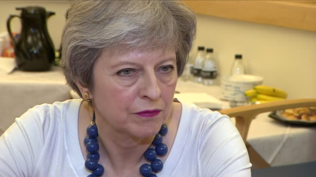 Interior shots of Prime Minister Theresa May sat in a meeting room and speaking to doctors and nurses at Addenbrooke's Hospital on 10th April 2018 in...