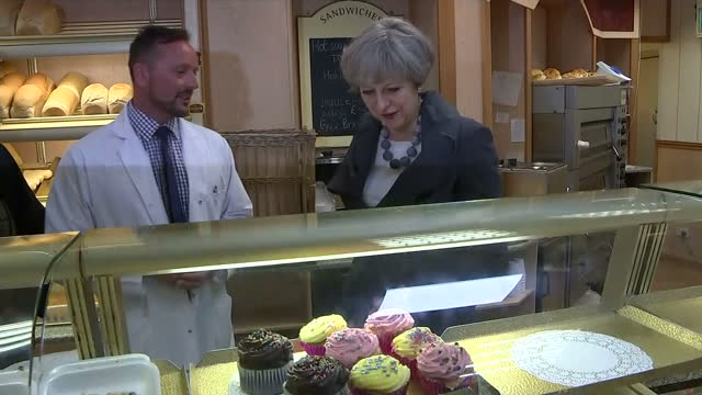 interior shots of prime minister theresa may visiting a bakery during a campaign visit to lancaster speaking to bakery staff and local conservative... - conservative party uk stock videos and b-roll footage