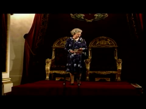 interior shots of prince charles' 50th birthday at buckingham palace shows queen mother talking to line up of guests queen making speech and giving... - the queen's speech state opening of uk parliament stock-videos und b-roll-filmmaterial