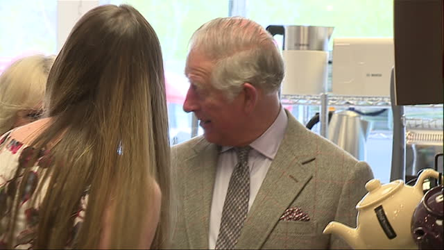 Interior shots of Prince Charles and Camilla Duchess of Cornwall meeting a staff member in a homewares shop whilst touring Ballater on 28 April 2017...
