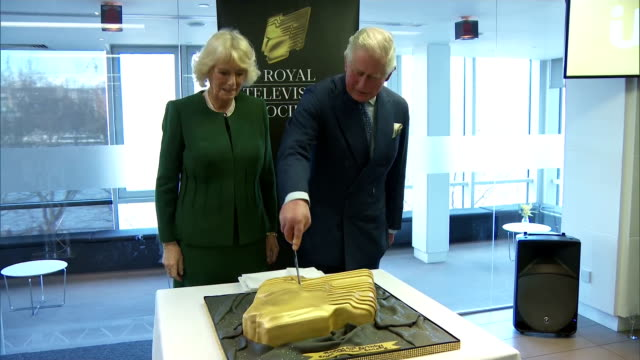 Interior shots of Prince Charles and Camilla Duchess of Cornwall cutting a special cake to celebrate the 90th Anniversary of the Royal Television...