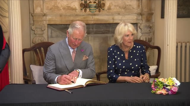 interior shots of prince charles and camilla duchess of cornwall signing a visitors book and being presented with a hamper of local produce on a trip... - コーンウォール公爵夫人 カミラ点の映像素材/bロール