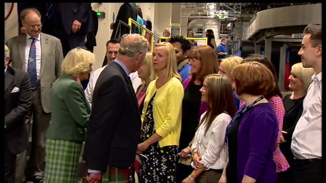 interior shots of prince charles and camilla duchess of cornwall meeting dc thomson co workers shaking hands and talking to them before leaving... - スコットランド ダンディー点の映像素材/bロール