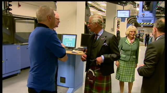 interior shots of prince charles and camilla duchess of cornwall rothesay meeting dc thomson and co employees on printing floor with machinery in... - スコットランド ダンディー点の映像素材/bロール