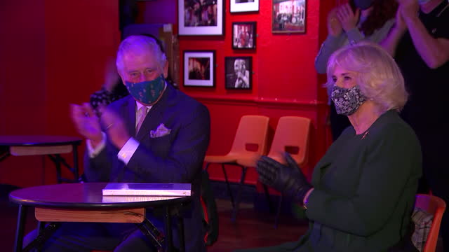 interior shots of prince charles and camilla duchess of cornwall visiting the 100 club, a basement music venue in london, sitting watching a live... - tapping stock videos & royalty-free footage