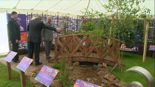 interior shots of prince charles and camilla, duchess of cornwall viewing the east anglia children's hospices nook appeal show garden in the royal... - east anglia stock-videos und b-roll-filmmaterial