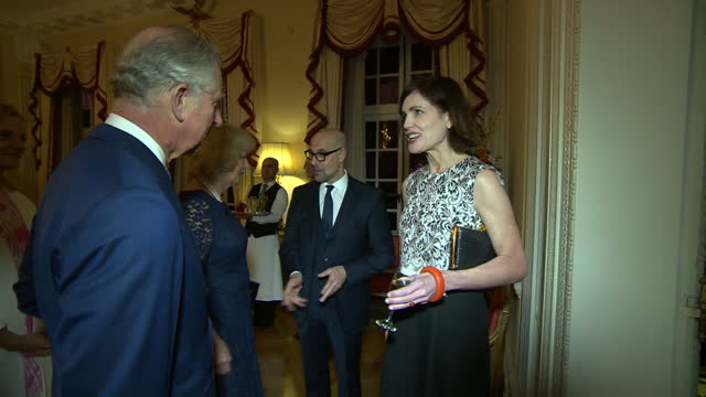 Interior shots of Prince Charles and Camilla Duchess of Cornwall speaking to actors Stanley Tucci and Elizabeth McGovern at a reception for Americans...