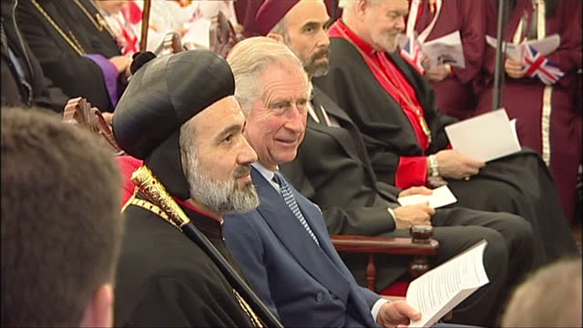 interior shots of prince charles and prince ghazi bin muhammad of jordan being presented with gifts from members of the syriac orthodox church at st.... - 王室点の映像素材/bロール