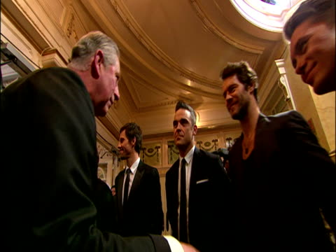 vidéos et rushes de interior shots of prince charles & camilla being introduced to royal variety show performers including kylie minogue, take that and n-dubz. charles &... - take that