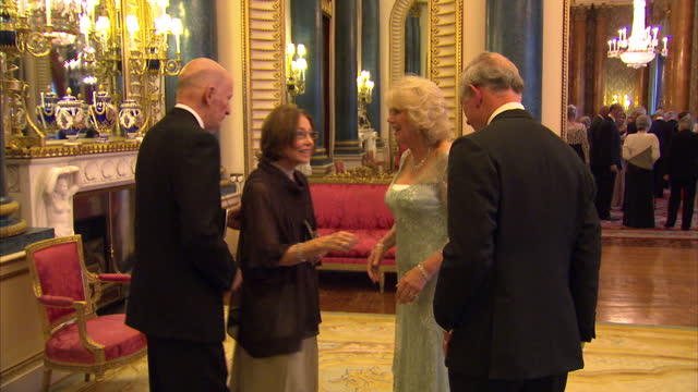 vídeos y material grabado en eventos de stock de interior shots of prince charles camilla duchess of cornwall greeting simeon ii and queen margarita of bulgaria at the sovereign dinner prince... - 2012