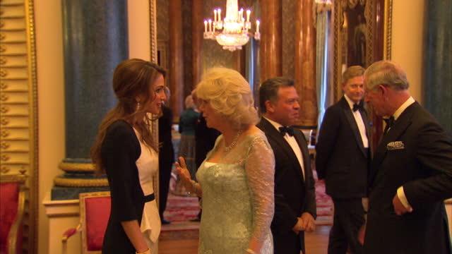 Interior shots of Prince Charles Camilla Duchess of Cornwall greeting King Abdullah II Bin AlHussein of Jordan and his wife Queen Rania Al Abdullah...