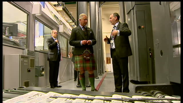 interior shots of prince charles camilla duchess of cornwall meeting workers in newspaper side of printing factory with papers headlines on screen... - dundee scotland stock videos and b-roll footage