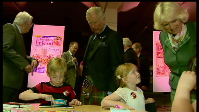 interior shots of prince charles duke of cambridge rothesay and camilla talking to children who are sitting at table reading magazines books charles... - dundee scotland stock videos and b-roll footage