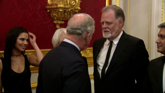 interior shots of prince charles greeting and mingling with guests at an invest in futures reception including shots of celebrity guests cheryl... - ハリー レッドナップ点の映像素材/bロール