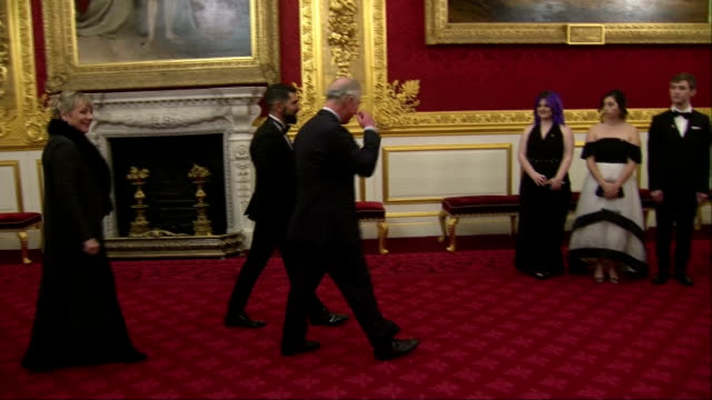 Interior shots of Prince Charles greeting officials and guests at an Invest in Futures reception including young people who have benefited from the...