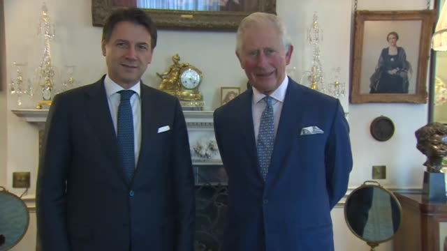 interior shots of prince charles italian prime minister giuseppe conte during a two-day nato summit and posing for a photocall on 3 december 2019 in... - フォトコール点の映像素材/bロール