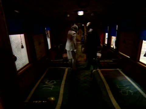 vidéos et rushes de interior shots of prince charles looking at railway train carriage and speaking with female as they walk around carriage. prince charles looking... - wagon