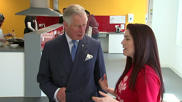 interior shots of Prince Charles meeting a social worker at the Morgan Stanley Centre with Ant Dec standing next to him wearing aprons during his...