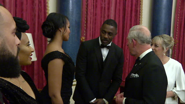 Interior shots of Prince Charles meeting guests including actor Idris Elba and singer Emeli Sande before the Prince's Trust One Million Young Lives...