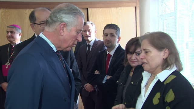 Interior shots of Prince Charles meeting members of the Iraqi Chaldean Christian community and listening to accounts of the effects of the conflict...