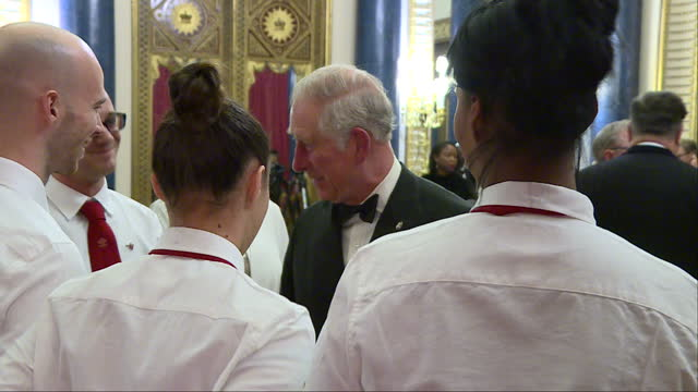 Interior shots of Prince Charles meeting organisers and catering staff before the Prince's Trust One Million Young Lives dinner at Buckingham Palace...