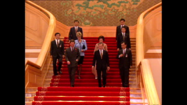 interior shots of prince charles, prince of wales, and princess diana, princess of wales, walking down staircase with south korean president roh tae... - roh moo hyun stock videos & royalty-free footage