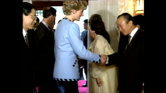 interior shots of prince charles, prince of wales, and princess diana, princess of wales, greeting guests at banquet during royal tour on 6 november... - 1992 stock videos & royalty-free footage