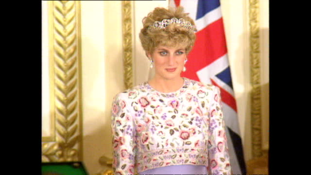 vídeos de stock e filmes b-roll de interior shots of prince charles, prince of wales, and princess diana, princess of wales, entering banquet and taking seats before standing for... - 1992
