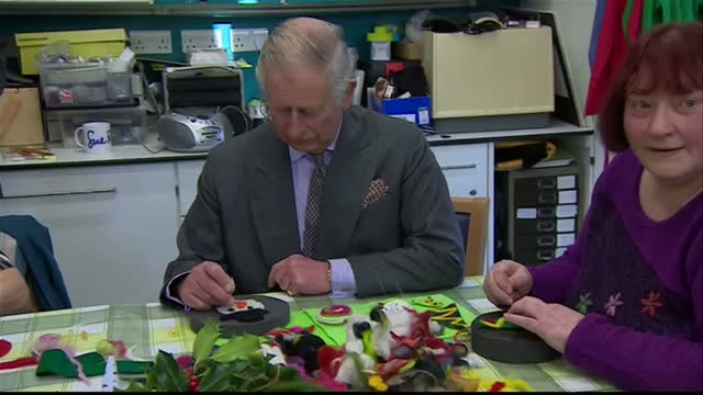 interior shots of prince charles prince of wales making a snowman out of felt on his visit to the sue ryder leckhampton court hospice on december 22... - making a snowman stock videos & royalty-free footage