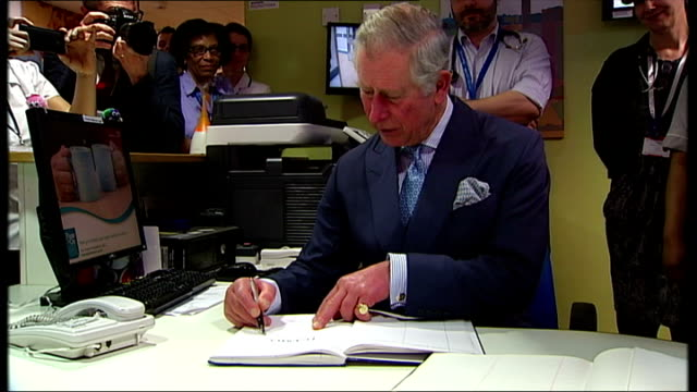 interior shots of prince charles prince of wales signing book in king's college hospital during visit with camilla duchess of cornwall on in london... - signierstunde stock-videos und b-roll-filmmaterial