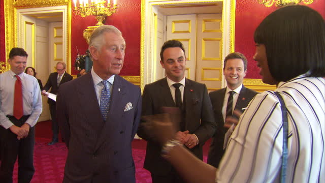 stockvideo's en b-roll-footage met interior shots of prince charles prince of wales talking to guests with tv personalities anthony mcpartlin declan donnelly 'ant dec' next to him at... - ant mcpartlin