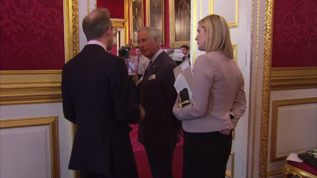 stockvideo's en b-roll-footage met interior shots of prince charles prince of wales talking to guests whilst drinking a cup of tea at st james' palace on may 13 2015 in london england - ant mcpartlin