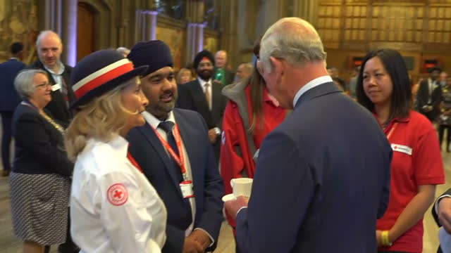 interior shots of prince charles speaking to a group of red cross workers during a reception at manchester town hall to thank those involved in the... - red cross stock videos & royalty-free footage