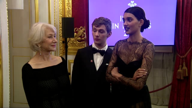 Interior shots of Prince Charles speaking to guests at an Invest in Futures reception at St James' Palace including actress Felicity Jones and posing...