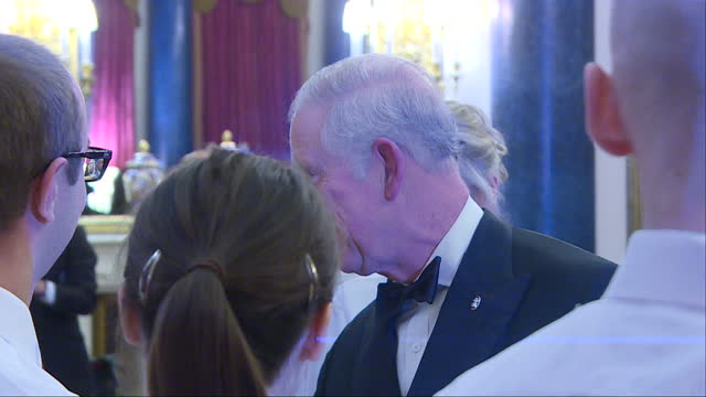 Interior shots of Prince Charles speaking to organisers and catering staff before the Prince's Trust One Million Young Lives dinner at Buckingham...