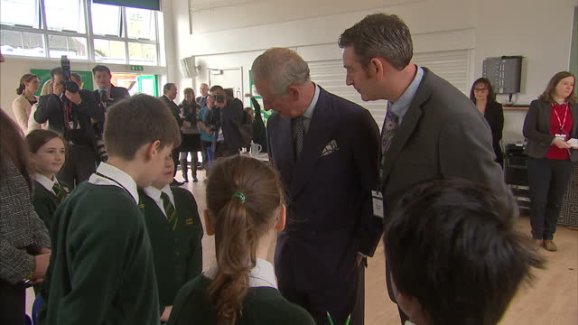Interior shots of Prince Charles speaking with teachers and children inside hall of Ashley Church of England Primary School on February 10 2016 in...