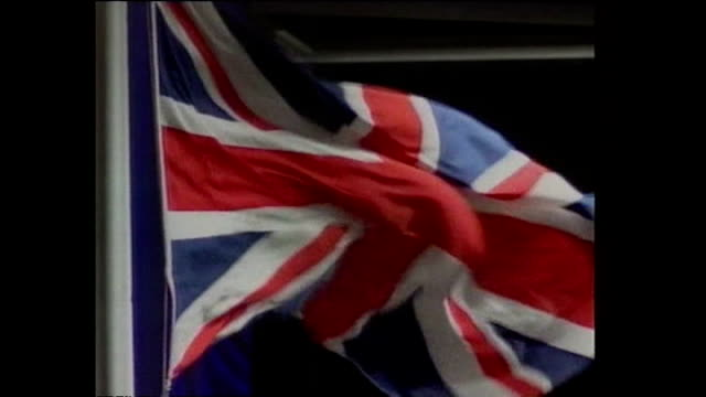 interior shots of prince charles, tony blair, robin cook and others arriving for the hong kong handover ceremony in a large hall, as union jack flags... - ceremony stock videos & royalty-free footage