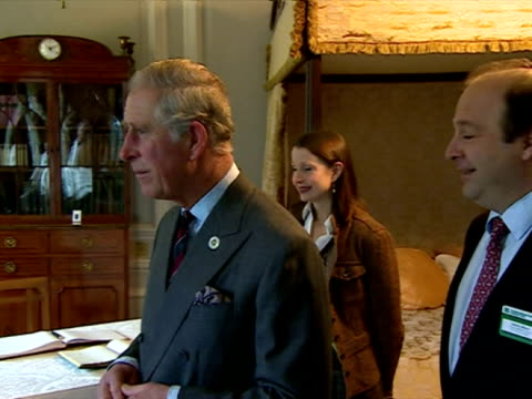interior shots of prince charles touring one of the restored bedrooms at tredegar house with national trust officials, signing the visitor's book and... - national trust video stock e b–roll
