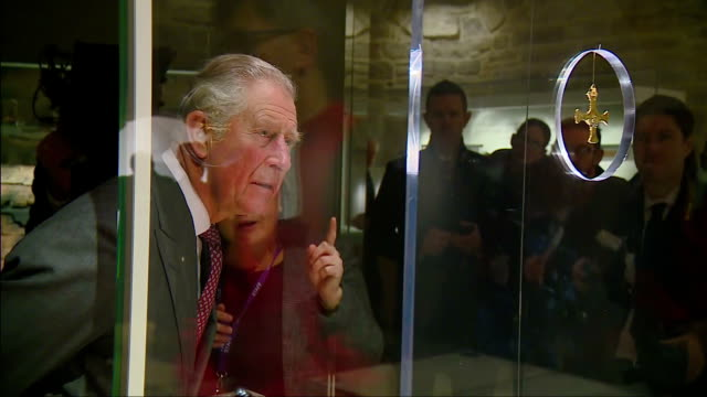 interior shots of prince charles touring the open treasure exhibition at durham cathedral and viewing parts of the treasures of st cuthbert... - イングランド ダラム点の映像素材/bロール