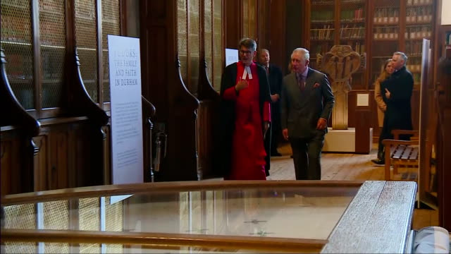 interior shots of prince charles touring the open treasure exhibition at durham cathedral and speaking to curators about some of the exhibits on... - イングランド ダラム点の映像素材/bロール