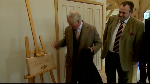 Interior shots of Prince Charles touring the workshop at the Timberpride sawmill unveiling an oak plaque to commemorate his visit and being presented...