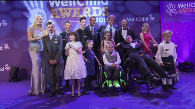 interior shots of prince harry and gaby roslin posing with wellchild award winners.>> on october 05, 2015 in london, england. - gaby roslin stock videos & royalty-free footage