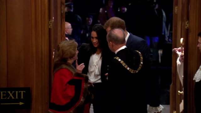 Interior shots of Prince Harry and his fiancee Meghan Markle arriving at Goldsmiths' Hall to attend the Endeavour Awards ceremony and being greeted...