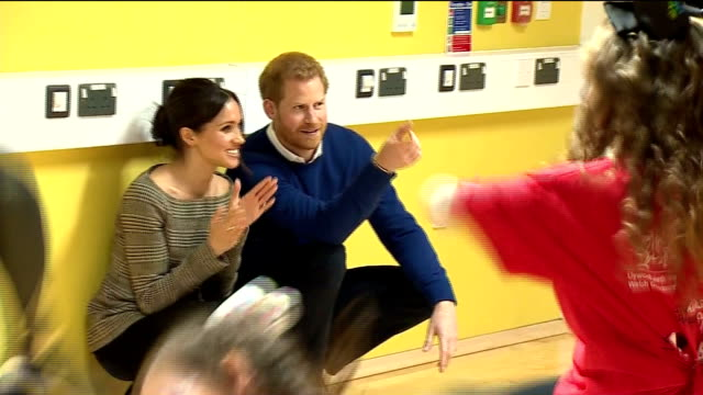 interior shots of prince harry and his fiancee meghan markle visiting the star hub community and watching groups of young people taking part in table... - fiancé stock videos and b-roll footage