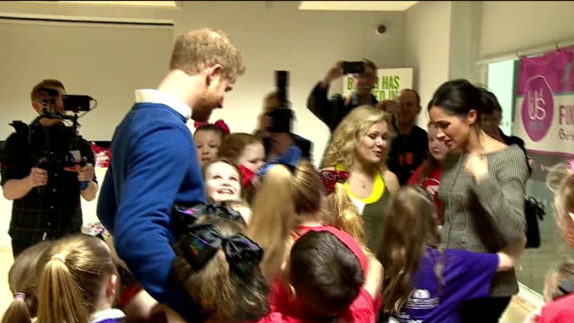 interior shots of prince harry and his fiancee meghan markle visiting the star hub community being hugged by a group of girls after watching a dance... - cardiff wales stock videos & royalty-free footage