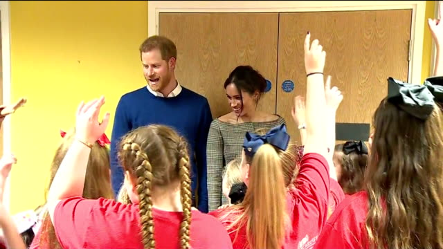 Interior shots of Prince Harry and his fiancee Meghan Markle visiting the Star Hub community and leisure centre in Cardiff and meeting a group of...